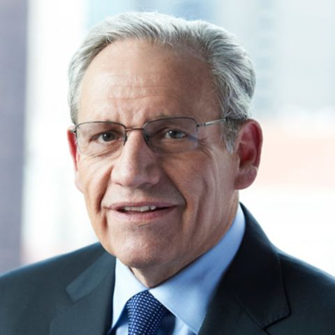Bob Woodward in a black suit poses a picture.