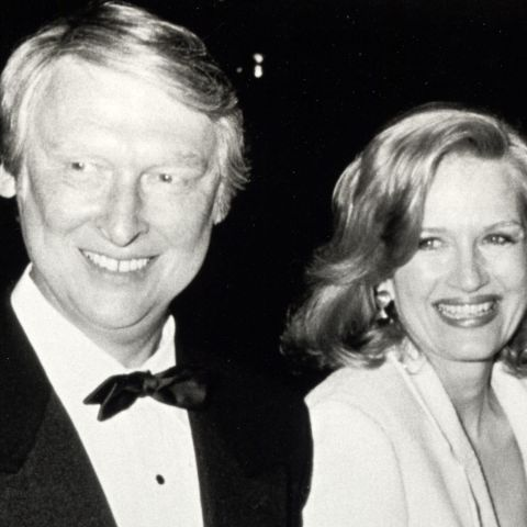 Diane Sawyer in a white dress poses for a picture with husband Mike Nichols.