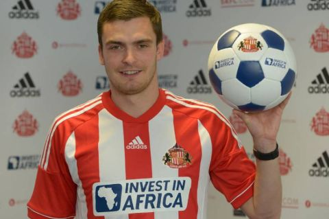 Adam Johnson poses in a Sunderland jersey.