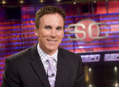 John Buccigross in a black suit in the studio of SportsCenter.