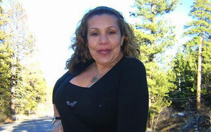 Mildred Patricia Baena in a black t-shirt poses for a picture.