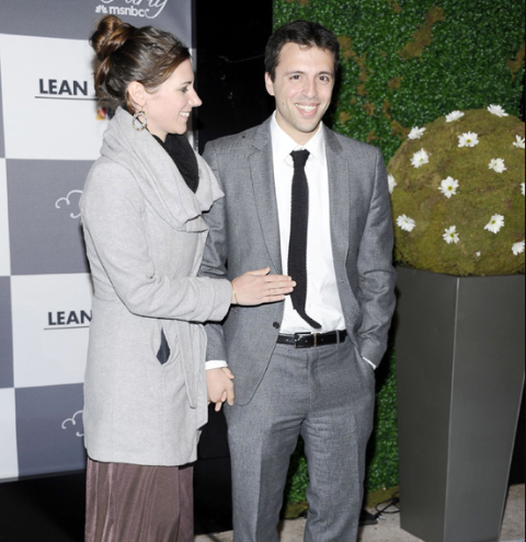 Ezra Klein poses a picture with his wife Annie Lowrey.