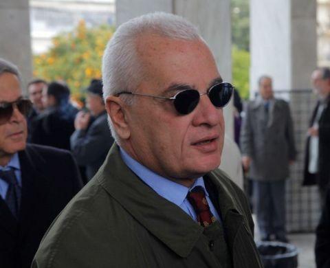 Giannis Pretenteris in a brown coat caught in the camera.