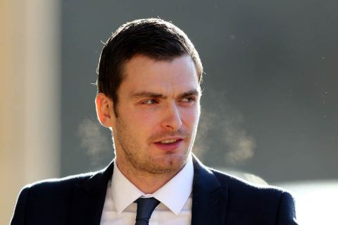 Adam Johnson in a black suit caught on the cameras.
