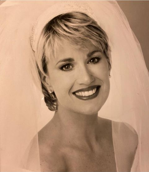 Jane Robelot in her wedding dress poses for a picture.