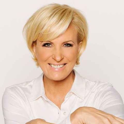 Mika Brzezinski in a white t-shirt poses for a picture.