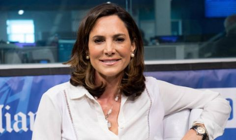 Maria Elvira Salazar in a white shirt poses at a studio.
