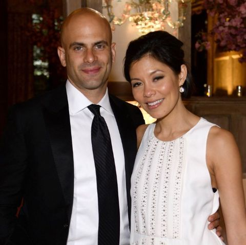 Sam Kass poses a picture with wife Alex Wagner.