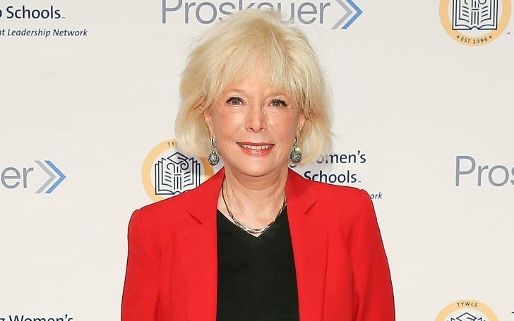 Lesley Stahl in a red coat poses for a picture.