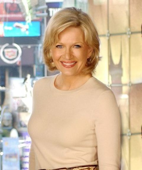 Diane Sawyer in a white t-shirt poses for a picture.
