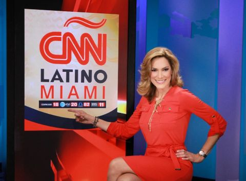 Maria Elvira Salazar in a red dress poses at the CNN studio.