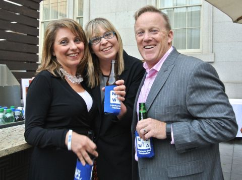 Rebecca Claire Miller poses with her husband Sean Spicer and a colleague.