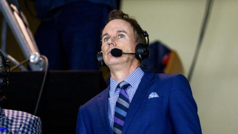 John Buccigross in a blue suit caught in camera.