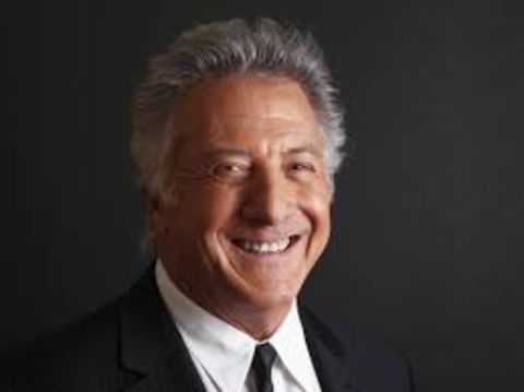 Dustin Hoffman smiling at the camera.