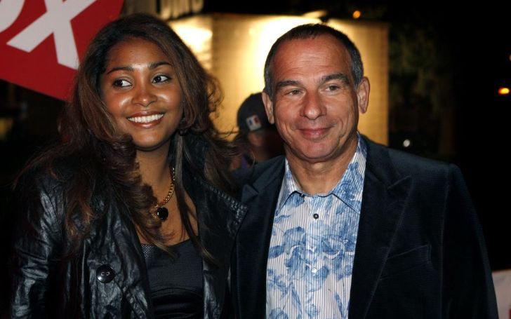 Mari Petell Rodriguez's husband Maurice de Hond poses a picture with a colleague.