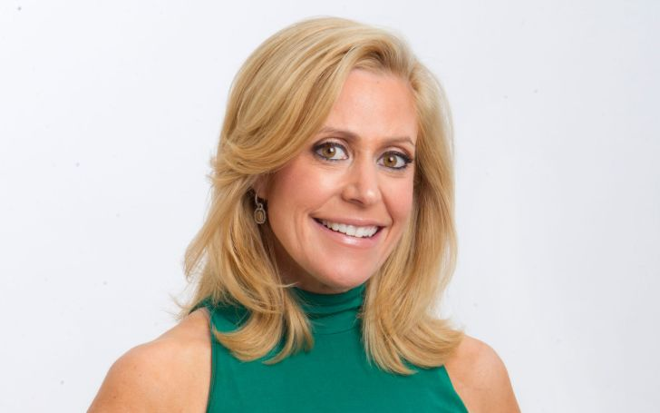 Melissa Francis in a green dress poses for a picture.