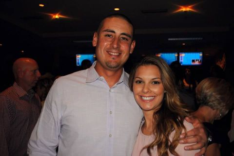 Allen Craig in a grey shirt poses with wife Marie LaMarca.