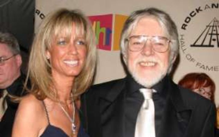 Juanita Dorricott in a blue dress poses with husband Bob Seger.