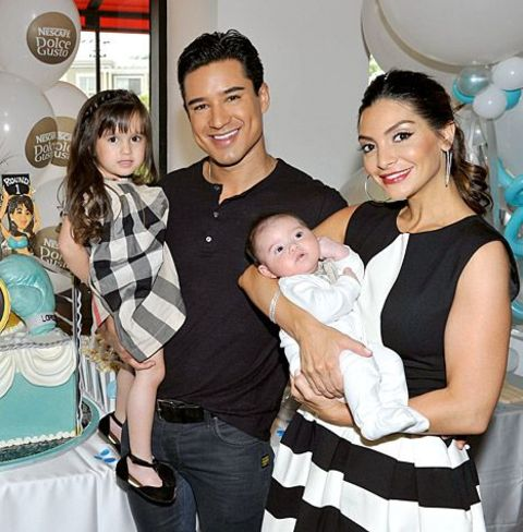 Mario Lopez and his wife Courtney Mazza pose with their children.