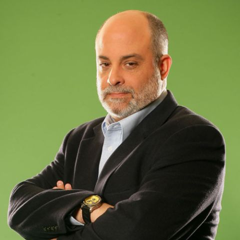 Mark Levin in a black coat poses for a picture.