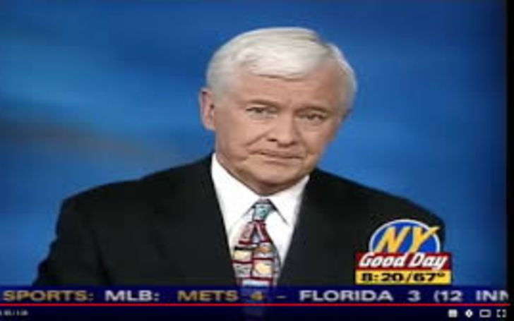 Jim Ryan in a black suit live on television.