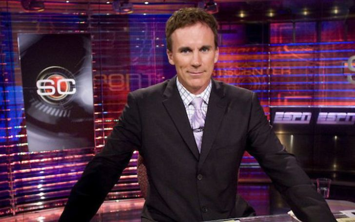 John Buccigross in a black suit in the ESPN Studio.