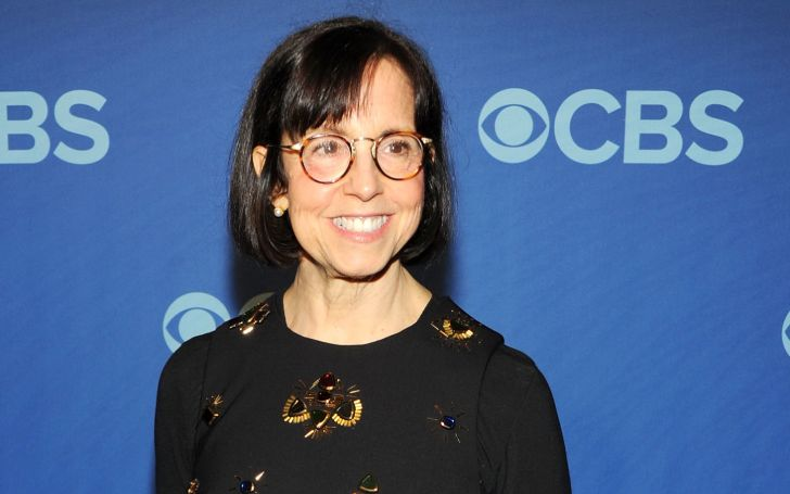 Susan Zirinsky in a black t-shirt poses for a picture.
