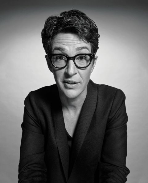 Rachel Maddow in a black coat poses for a picture.