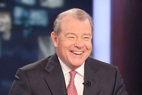 Stuart Varney in a black suit and pink tie caught on camera.