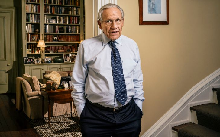 Bob Woodward in a white shirt poses for a picture.