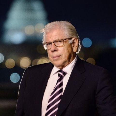Carl Bernstein in a black suit poses a picture.
