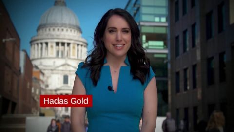 Hadas Gold in a blue dress reporting for CNN.