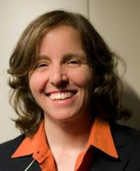 Megan Smith in a black t-shirt poses for a picture.
