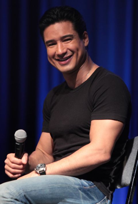 Mario Lopez in a black t-shirt caught in the camera.