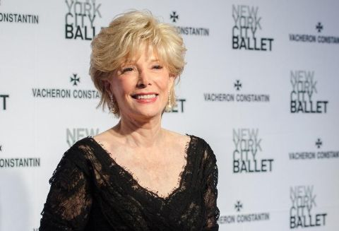 Lesley Stahl in a black dress poses for a picture.