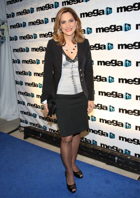 Maria Elvira Salazar in a black skirt and coat poses a picture.
