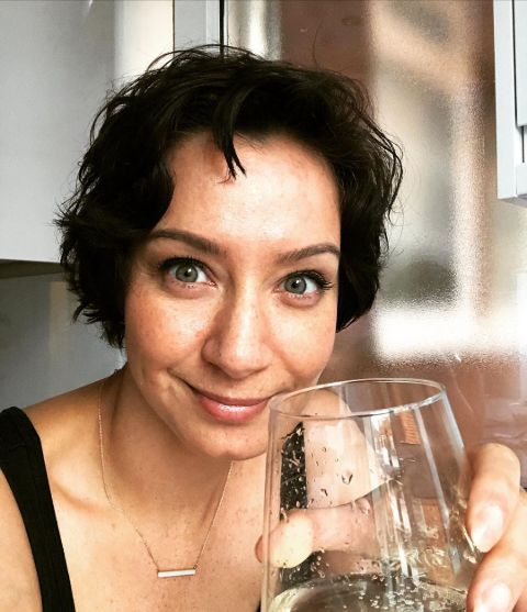Crystal Goomansingh poses with a wine glass.