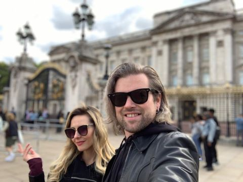 Kasia Bodurka poses with her husband Tommy Layrite at Buckingham Palace.