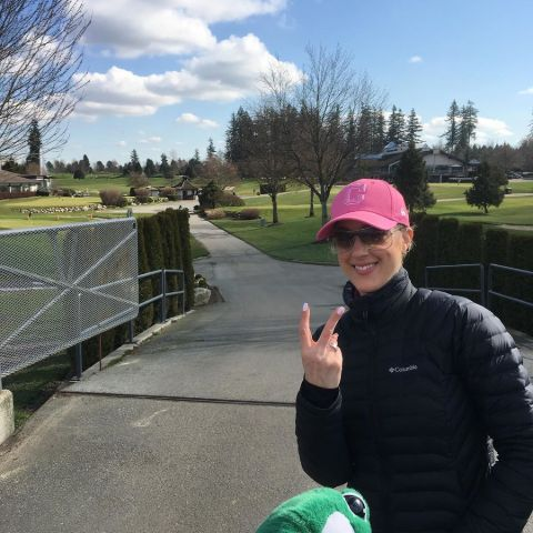 Anne Drewa poses a picture at a golf course.