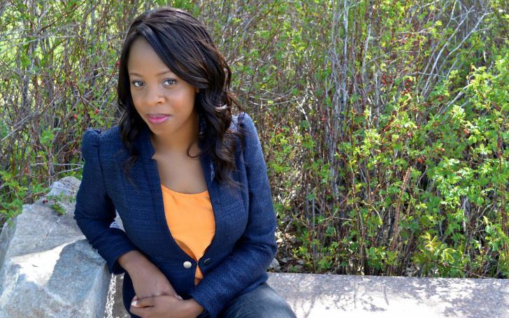 Nadia Stewart in a black jacket poses for a picture.