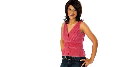 Sonia Deol  in a pink top poses for a picture.