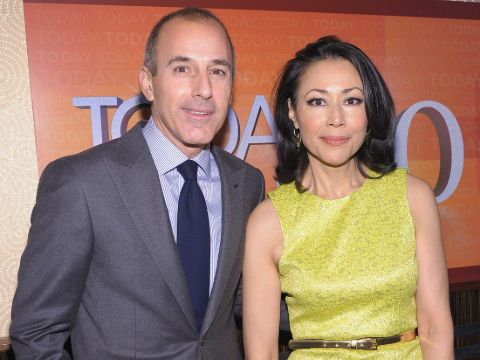 Ann Curry in a yellow dress poses a picture with her husband.