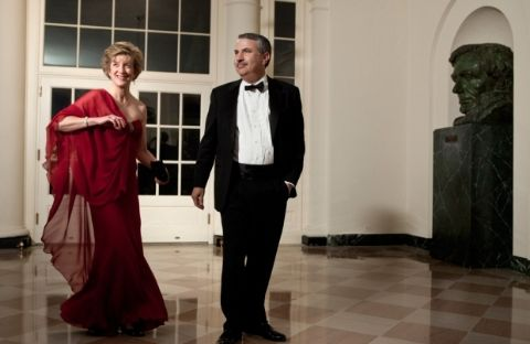 Thomas Friedman in a black suit poses with his wife Ann Bucksbaum.