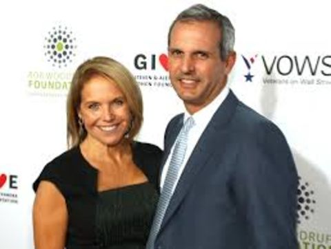 Katie Couric in a black dress poses with her husband John Molner.