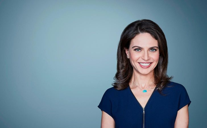 Bianna Golodryga in a black dress poses for a picture.