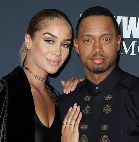 Terrence J in a black t-shirt poses for a picture with ex-girlfriend Jasmine Sanders.