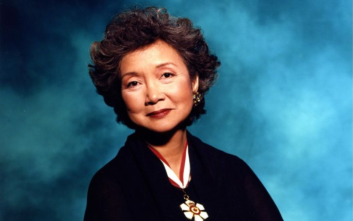 Adrienne Clarkson in a black coat poses for a picture.