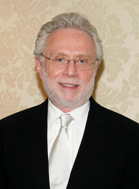 Wolf Blitzer in a black suit poses for a picture.