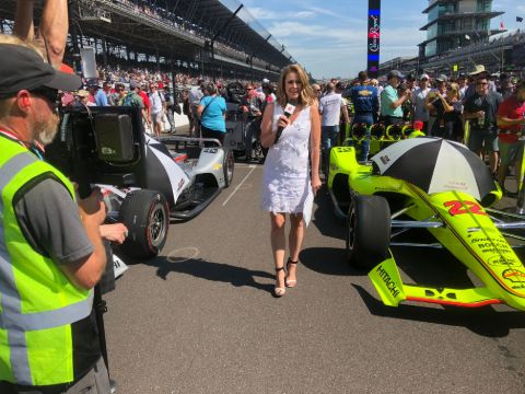 Nicole Briscoe  poses a picture while covering a auto-race event.