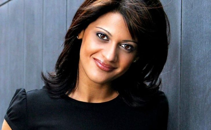 Sonia Deol in a black dress poses for a picture.